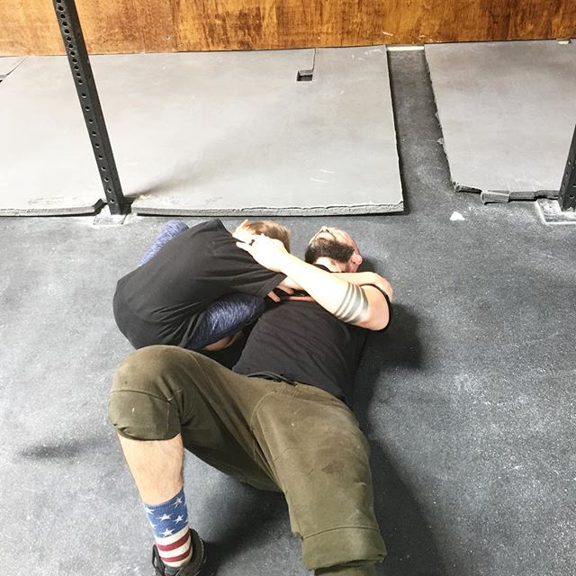 """He didn't hear the self doubting voice in my head saying """"this is way too hard, why didn't you scale"""", he didn't feel my quads knotting up or the strain in my knees trying to get far enough to rep out the last lunge and he definitely didn't care about my internal frustrations for failing at the muscle ups. No, all he saw with pride in his eyes was his dad being a boss for 12 minutes and working his ass off. And it will shape the choices he'll make for himself and the man he will one day be. Aftermath of the 2017 CrossFit 17.2 Open workout. @crossfit @crossfitjournal"""