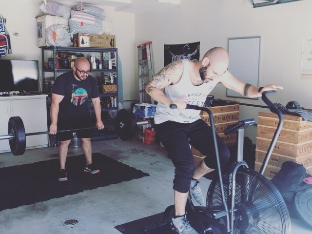 Saturday's are for the boys. It went down today. .. 25 AMRAP EMOM Max deads 135 # Ass bike OTS Bag Toss 90 # Russian KBS 44 # . . . Programming and garage box by @mrmannyflow3rs @ckgoodchild